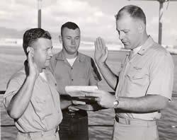Chief Radioman Edward Brown, Boat Yeoman Olszewski, and Commanding Officer, Doug Stahl Reenlistment Ceremony.